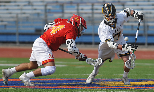 Jake Naso #17 of St. Anthony's, right, and Tyler Sandoval #34 of Chaminade battle for control of a faceoff during the Nassau-Suffolk CHSAA varsity boys lacrosse Class AA final at Mitchel Athletic Complex on Tuesday, May 15, 2018. The game went to halftme tied 8-8 when a prolonged lightning storm forced a postponement.