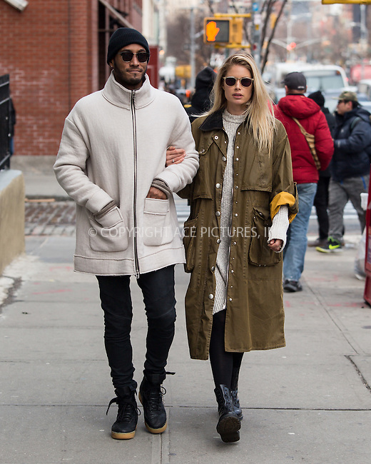 www.acepixs.com<br /> <br /> February 14 2017, New York City<br /> <br /> Model Doutzen Kroes and her husband Sunnery James walks in Soho on February 14 2017 in New York City<br /> <br /> By Line: John Peters/ACE Pictures<br /> <br /> <br /> ACE Pictures Inc<br /> Tel: 6467670430<br /> Email: info@acepixs.com<br /> www.acepixs.com