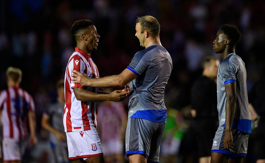 Lincoln City's Matt Rhead, right, shakes hands with Stoke City's Tyrese Campbell at the end of the game<br /> <br /> Photographer Chris Vaughan/CameraSport<br /> <br /> Football Pre-Season Friendly - Lincoln City v Stoke City - Wednesday July 24th 2019 - Sincil Bank - Lincoln<br /> <br /> World Copyright © 2019 CameraSport. All rights reserved. 43 Linden Ave. Countesthorpe. Leicester. England. LE8 5PG - Tel: +44 (0) 116 277 4147 - admin@camerasport.com - www.camerasport.com