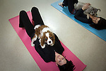 NEW YORK  -  MARCH 04, 2009:  Katie Bell does a pose with her dog Riley during a dog yoga class at the Bideawee Learning Center on March 4, 2009 in New York City.  (PHOTOGRAPH BY MICHAEL NAGLE)
