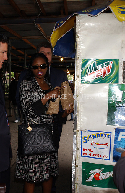 WWW.ACEPIXS.COM . . . . . ....NEW YORK, MAY 6, 2005....Foxy Brown stops for a snack from a street vendor as she leaves her hearing regarding charges of assault from a Chelsea manicurist.....Please byline: KRISTIN CALLAHAN - ACE PICTURES.. . . . . . ..Ace Pictures, Inc:  ..Craig Ashby (212) 243-8787..e-mail: picturedesk@acepixs.com..web: http://www.acepixs.com
