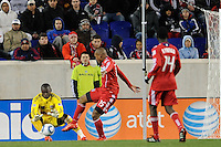 New York Red Bulls goalkeeper Bouna Coundoul (18) makes a stop on Collins John (15) of the Chicago Fire during the second half of a Major League Soccer match between the New York Red Bulls and the Chicago Fire at Red Bull Arena in Harrison, NJ, on March 27, 2010. The Red Bulls defeated the Fire 1-0.