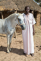 Senegalese Farmer and his Horse.  Bijam, a Wolof Village, near Kaolack, Senegal.