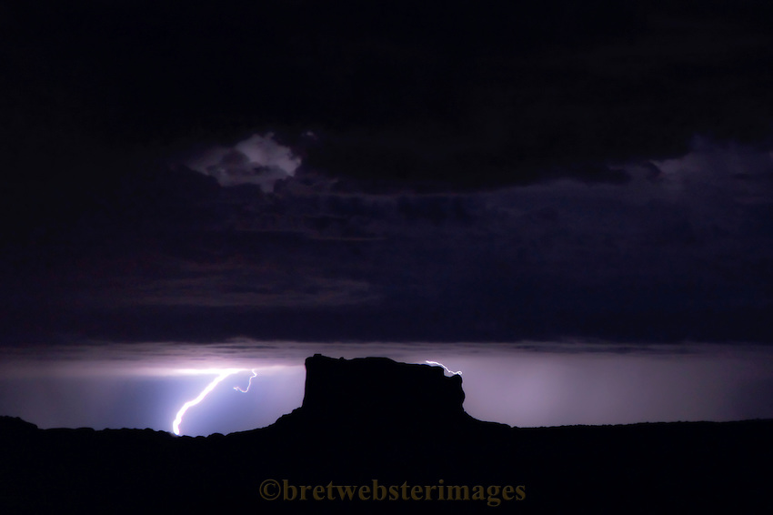 Night Lightning frames a lonely butte near Dead Horse Point, Utah.