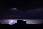 Night Lightning frames a lonely butte near Dead Horse Point, Utah.