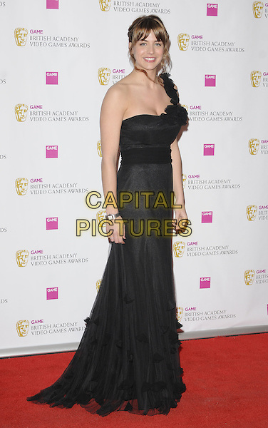 GEMMA ATKINSON .The Game BAFTA Video Game Awards, Hilton Hotel, Park Lane, London, England, UK, 16th March 2011..full length black strapless dress long maxi  one strap ruffles ruffle .CAP/CAN.©Can Nguyen/Capital Pictures.