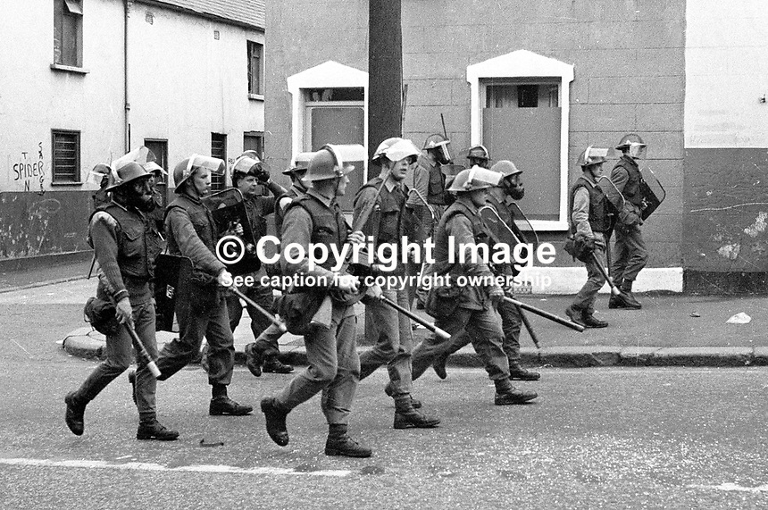 Soldiers on foot patrol during the curfew. 197007030251b..The British Army imposed during July 3 & 4, 1970, a 34 hour curfew (except for a two hour break to allow shopping) in approximately 50 streets in the Lower Falls district of Belfast, N Ireland, UK. A military helicopter hovered overhead warning people they would be arrested if they remained on the streets. An army search during the curfew uncovered 100 firearms, 100 home-made bombs, 250 lbs of explosives, 21000 rounds of ammunition and 8 two-way radios. This curfew is often seen as a turning point in souring relations between the Roman Catholic working class and the British Army. The army was no longer seen as the protector of the Catholic community...Copyright Image from Victor Patterson, 54 Dorchester Park, Belfast, UK, BT9 6RJ..Tel: +44 28 9066 1296.Mob: +44 7802 353836.Voicemail +44 20 8816 7153.Skype: victorpattersonbelfast.Email: victorpatterson@mac.com.Email: victorpatterson@ireland.com (back-up)..IMPORTANT: If you wish to use this image or any other of my images please go to www.victorpatterson.com and click on the Terms & Conditions. Then contact me by email or phone with the reference number(s) of the image(s) concerned.