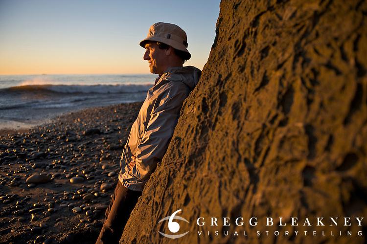 A hiker enjoys sunset at Ruby Beach - Olympic National Park