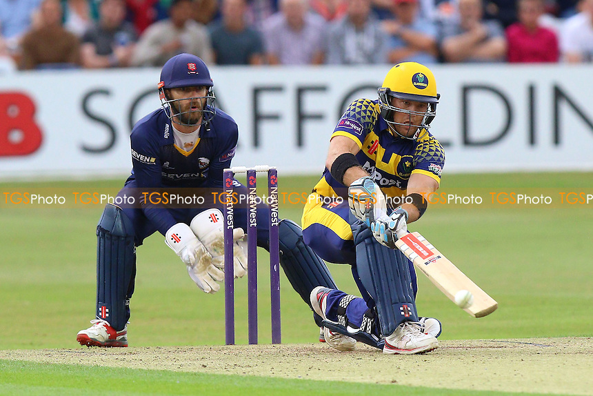 Colin Ingram in batting action for Glamorgan as James Foster looks on from behind the stumps during Essex Eagles vs Glamorgan, NatWest T20 Blast Cricket at the Essex County Ground on 29th July 2016