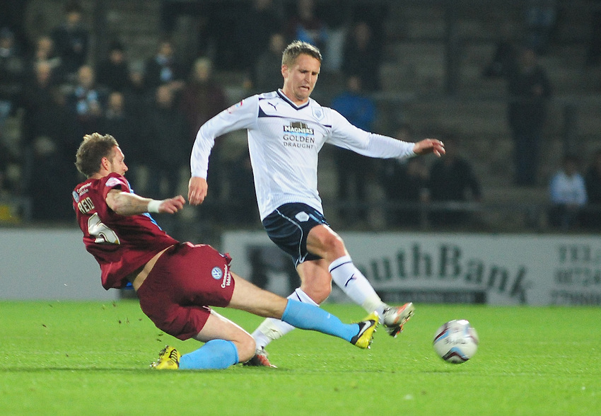 Preston North End's Nicky Wroe skips past the challenge of Scunthorpe United's Paul Reid ..Football - npower Football League Division One - Scunthorpe United v Preston North End - Tuesday 23rd October 2012 - Glanford Park - Scunthorpe..