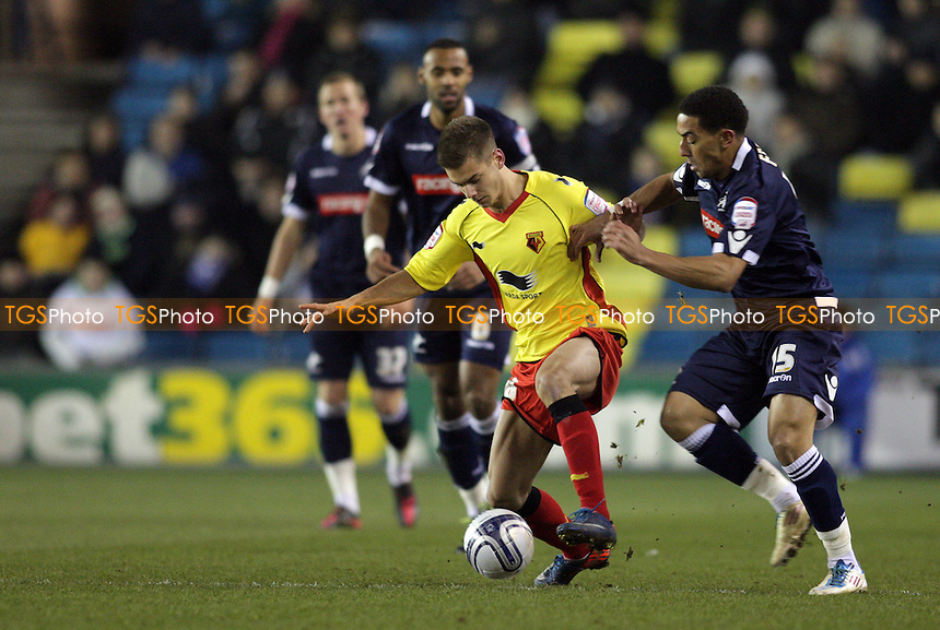 Alex Kačaniklić of Watford FC controls the ball in front of Scott Barron of Millwall FC - Millwall vs Watford - nPower Championship Football at the New Den, London - 31/01/12 - MANDATORY CREDIT: Helen Watson/TGSPHOTO - Self billing applies where appropriate - 0845 094 6026 - contact@tgsphoto.co.uk - NO UNPAID USE.