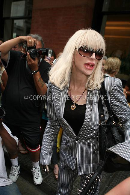 WWW.ACEPIXS.COM ** ** ** ....July 13 2007, New York City....Singer Courtney Love checks out of her downtown Manhattan hotel amidst an enormous crowd of photographers and onlookers.......Please byline: Philip Vaughan -- ACEPIXS.COM.. *** ***  ..Ace Pictures, Inc:  ..tel: (646) 769 0430..e-mail: info@acepixs.com..web: http://www.acepixs.com