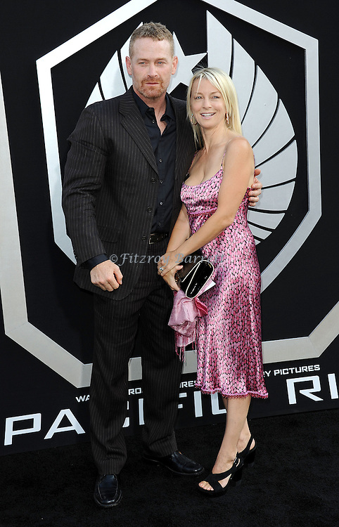 "Max Martini and wife Kim Restell arriving to the Los Angeles premiere of ""Pacific Rim"" held at the Dolby Theater on July 9, 2013."