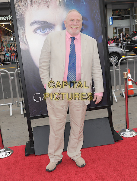 "James Cosmo.""Game Of Thrones"" 3rd Season Los Angeles Premiere held at the TCL Chinese Theatre, Hollywood, California, USA..March 18th, 2013.full length hand in pocket blue beige pink tie suit shirt beard facial hair .CAP/RKE/DVS.©DVS/RockinExposures/Capital Pictures."