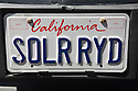A close up of a 'SOLR RYD' (Solar Ride) license plate promoting electric vehicles charged with solar generated energy. Electric Vehicle Rally in Palo Alto. Hosted by the Silicon Valley Chapter of the Electric Auto Association. Palo Alto, California, USA