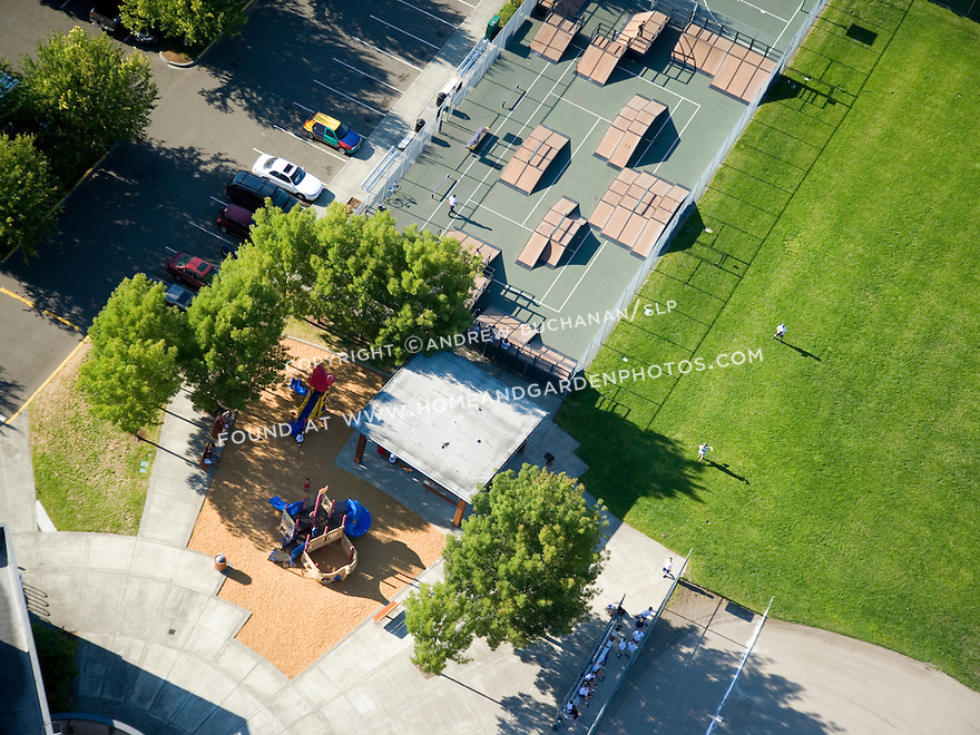 A sunny, summer afternoon aerial photo detail of the playground and skate park at the Tukwila Community Center in Tukwila, WA just south of Seattle.