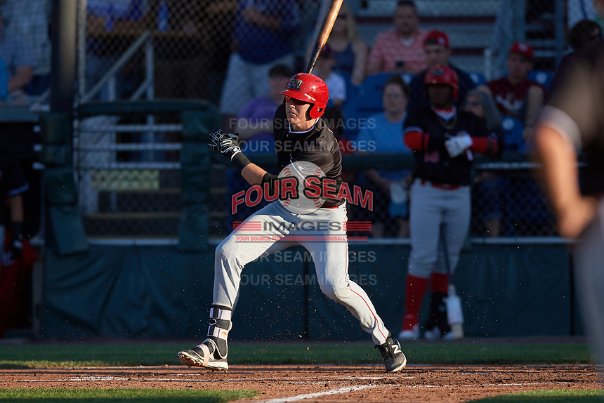 Batavia Muckdogs first baseman Sean Reynolds (25) follows through on a swing during a game against the Auburn Doubledays on June 15, 2018 at Falcon Park in Auburn, New York.  Auburn defeated Batavia 5-1.  (Mike Janes/Four Seam Images)