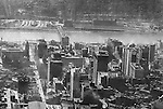 Pittsburgh PA:  Aerial view of City of Pittsburgh skyline looking southwest over the Pennsylvania Railroad Station toward the Monongahela River, the South Side and the P&LE Railroad building and rail yards across the river - 1923.