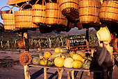 Bahia, Brazil. Roadside rural market stall selling baskets, squash and dende palm oil.