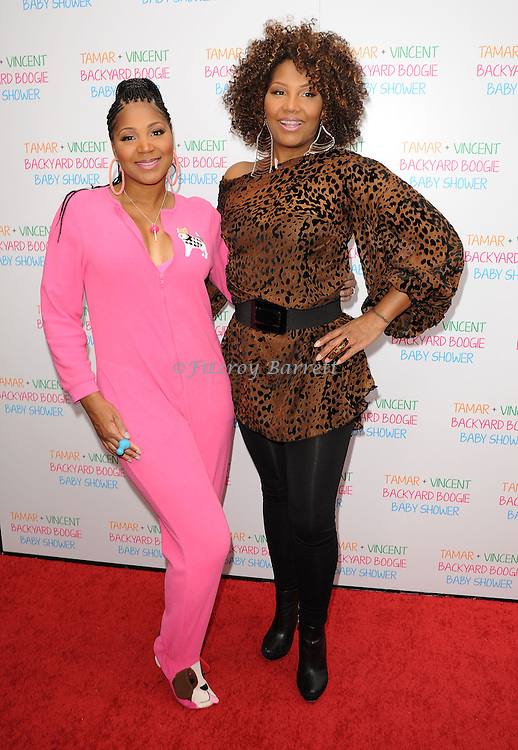 May 5, 2013   Beverly Hills, Ca..Trina Braxton and Traci Braxton.Tamar Braxton celebrates her Carnival Themed Baby Shower with friends and family, at the Hotel Bel Air..© Fitzroy Barrett / AFF-USA.COM