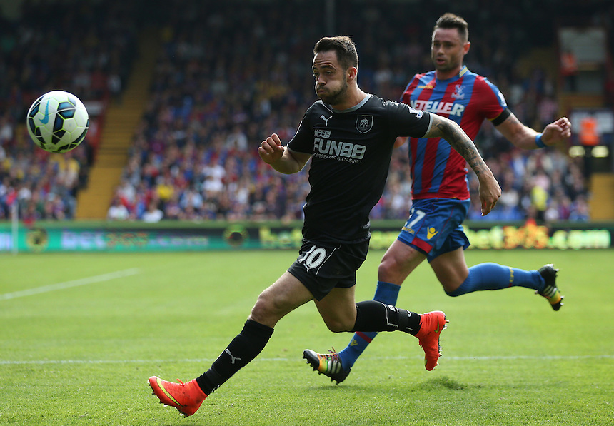 Burnley's Danny Ings despite the attentions of  Crystal Palace's Damien Delaney <br /> <br /> Photographer Kieran Galvin/CameraSport<br /> <br /> Football - Barclays Premiership - Crystal Palace v Burnley - Saturday 13th September 2014 - Selhurst Park - London<br /> <br /> &copy; CameraSport - 43 Linden Ave. Countesthorpe. Leicester. England. LE8 5PG - Tel: +44 (0) 116 277 4147 - admin@camerasport.com - www.camerasport.com