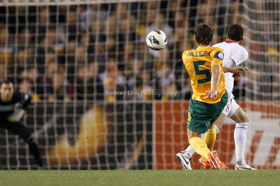 MELBOURNE, 11 JUNE 2013 - Mark MILLIGAN of Australia kicks for goal in a Round 4 FIFA 2014 World Cup qualifier match between Australia and Jordan at Etihad Stadium, Melbourne, Australia. Photo Sydney Low for Zumapress Inc. Please visit zumapress.com for editorial licensing. *This image is NOT FOR SALE via this web site.
