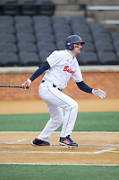Anthony Gingerelli (7) of the Bucknell Bison follows through on his swing against the Georgetown Hoyas at Wake Forest Baseball Park on February 14, 2015 in Winston-Salem, North Carolina.  The Hoyas defeated the Bison 8-5.  (Brian Westerholt/Four Seam Images)