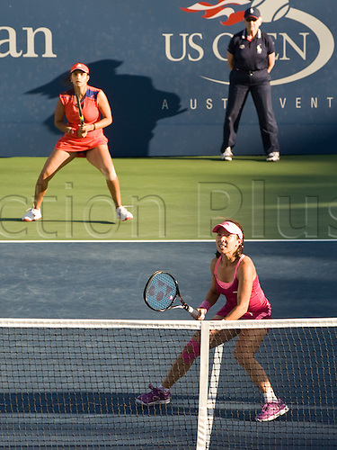 05.09.2013. New York, USA.  Sania Mirza of India and Jie Zheng of China during their women's doubles semi-final during the US Open Tennis Championships at the Billie Jean King National Tennis Center in Flushing, New York.