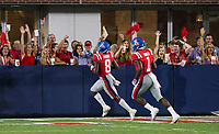NWA Democrat-Gazette/BEN GOFF @NWABENGOFF<br /> Fans cheer as Elijah Moore (8), along with Jonathan Mingo, both Ole Miss wide receivers, runs through the end zone on a 46 yard touchdown catch in the fourth quarter vs Arkansas Saturday, Sept. 7, 2019, at Vaught-Hemingway Stadium in Oxford, Miss.
