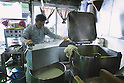 Tokyo, Japan - Yutaka Takayanagi (65) is working as a Tofu maker. He makes approximately 600 pieces of tofu everyday. Tofu is an Asian food made from soy milk.<br /> <br /> He runs Takayanagi Tofu shop in Chuo-ku, Tokyo with his family. He has a wife and two children. His son is also a Tofu maker and managing their shop as well.<br /> <br /> He started his career when he was a student back 45 years ago because of the staff shortage; he had helped out his family. First of all, what he managed was delivering Tofu by a bicycle. He began making Tofu following his father's examples and he says, &quot;I sold so many Tofu, which were not really perfect haha, but now I am very satisfied of what I make&quot;. He considers Tofu's hardness is very important; changing it depends on his customer's usages. (Ex, Fried Tofu should be harder than Tofu to be eaten raw.)<br /> <br /> He usually wakes up around 5 AM and starts working as soon as he gets up. It takes an hour to make Tofu after the processes such as compression, boiling and crushing beans, and more progresses. Their clients are mainly restaurants, cafeterias of institutions, schools, residents of the area and so on. Their main sales are provided by delivery services.<br /> <br /> These days, Tofu sweets are getting very popular and popular, such as Tofu ice cream, yoghurt, pudding, and etc,. He thinks those are tasty and interesting, but he is not trying to expand his business rather than making Tofu as this traditional way.<br /> <br /> While the shop is open, friendly customers come to buy their hand-made Tofu, which is not much around Tokyo area due to the machinery manufacturing. On the other hand, Takayanagi Tofu shop keeps their recipe of making handmade Tofu for more than 80 years. For the next generation, his son is going to take over the Tofu master's position. However, Yutaka says, &quot;My son still needs to work on more and more!&quot;