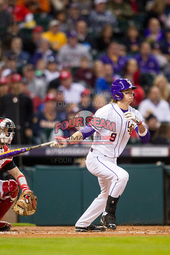 LSU Tigers outfielder Mark Laird (9) follows through on his swing during the NCAA baseball game against the Houston Cougars on March 6, 2015 at Minute Maid Park in Houston, Texas. LSU defeated Houston 4-2. (Andrew Woolley/Four Seam Images)