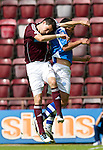 Hearts v St Johnstone...04.08.12.Ryan McGowan leads with the elbow in this challenge on Callum Davidson but was only give a yellow card..Picture by Graeme Hart..Copyright Perthshire Picture Agency.Tel: 01738 623350  Mobile: 07990 594431