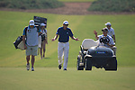 Sergio Garcia having a word with the referee as they walk down the 12 during the final round of the Dubai World Championship on the Earth Course at the Jumeirah Golf Estate, Dubai..Picture Fran Caffrey/www.golffile.ie.