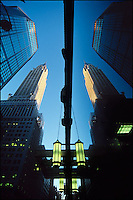 Chrysler Building with reflection in window.