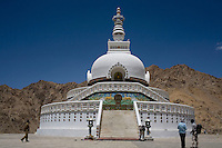 Tourists and local Ladakhis visit Shanti Stupa, the latest addition to skyline of Leh town, Ladakh, Jammu & Kashmir, India, on 31st May 2009. Shanti Stupa was built by the Japanese and sits atop a 100m high hill, accessible climbing by 566 steps.  Photo by Suzanne Lee
