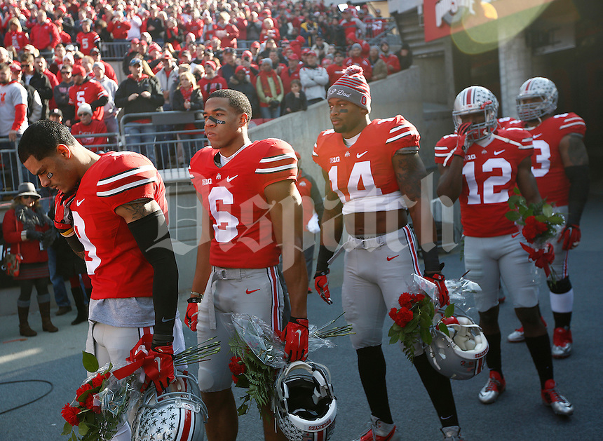Ohio State seniors line up to be called out onto the field before the college football game between the Ohio State Buckeyes and the Michigan Wolverines at Ohio Stadium in Columbus, Saturday morning, November 29, 2014. The Ohio State Buckeyes defeated the Michigan Wolverines 42 - 28. (The Columbus Dispatch / Eamon Queeney)