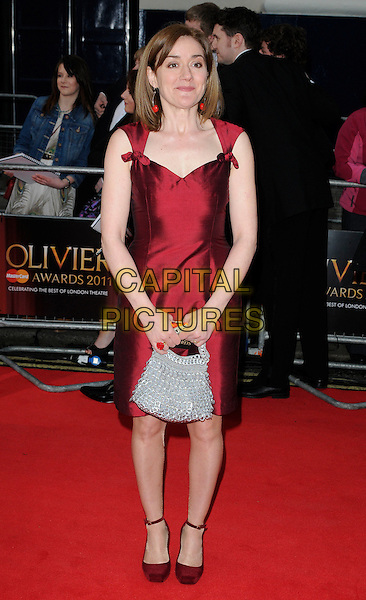 SOPHIE THOMPSON.The 35th Laurence Olivier Awards,.Theatre Royal, Drury Lane, London.England, UK..March 13th 2011.full length red dress shoes grey gray handbag .CAP/CAN.©Can Nguyen/Capital Pictures.