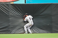 Akron RubberDucks center fielder Bradley Zimmer (6) crashes into the wall during the second game of a doubleheader against the Bowie Baysox on June 5, 2016 at Prince George's Stadium in Bowie, Maryland.  Bowie defeated Akron 12-7.  (Mike Janes/Four Seam Images)