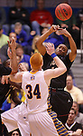 SIOUX FALLS, SD - MARCH 9:  Jordan Shanklin #10 of IUPUI tries to grab a rebound over Tony Fiegen #34 of South Dakota State during their quarter-final game at the 2013 Summit League Basketball Championships at the Sioux Falls Arena Saturday. (Photo by Dick Carlson/Inertia)