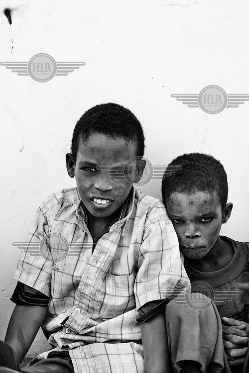 Young Somali refugees, Ali (10) and his sibling Abshir (7) wait outside the registration centre at the IFO-1 camp part of the Dadaab refugee camp in Kenya. The drought is the worst in East Africa for 60 years. The UN described it as a humanitarian emergency. The already overcrowded complex received 1,000 new refugees a day in June, five times more than a year ago. About 30,000 people arrived at the Dadaab refugee camp in June, according to UNHCR compared to 6,000 in June 2010.