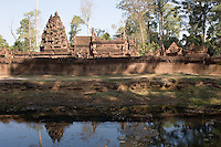 "The many delicate carvings at Banteay Srei have given the temple its name of ""The Jewel of Khmer Art"" but it also looks beautiful from across its moat. It was orginally built in 967AD, at the height of the Khmer Empire although, unusually, not by one of the Khmer Emperors."