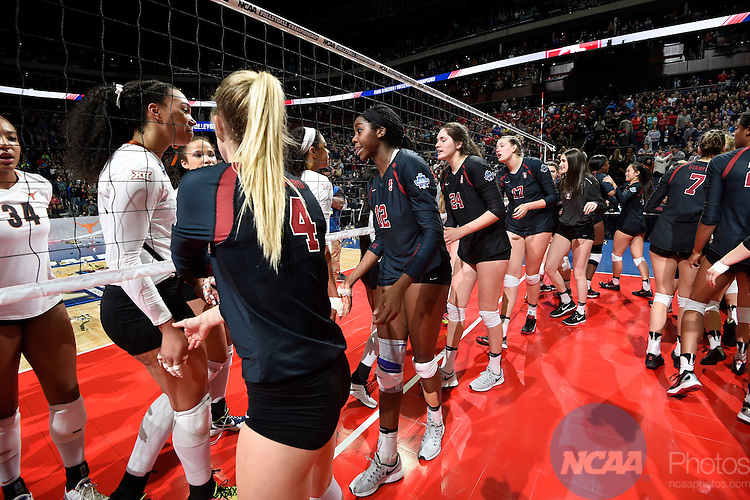 COLUMBUS, OH - DECEMBER 17:  Stanford University and the University of Texas shake hands following the Division I Women's Volleyball Championship held at Nationwide Arena on December 17, 2016 in Columbus, Ohio.  Stanford defeated Texas 3-1 to win the national title. (Photo by Jamie Schwaberow/NCAA Photos via Getty Images)