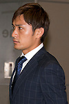 """Japan national football team, Toshihiro Aoyama, June 27, 2014, Chiba, Japan - Toshihiro Aoyama arrives at Narita International Airport with other members of the Japan national football team. Members of the Japan national football team arrives at Narita with a disappointed look on their faces. They couldn't advance to the final 16 in """"2014 FIFA World Cup Brazil"""" and came back earlier. (Photo by Rodrigo Reyes Marin/AFLO)"""