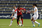 15 October 2014: Tasha St Louis (TRI) (10) is defended by Christie Rampone (USA) (3) and Lauren Holiday (USA) (12). The United States Women's National Team played the Trinidad and Tobago Women's National Team at Sporting Park in Kansas City, Kansas in a 2014 CONCACAF Women's Championship Group A game, which serves as a qualifying tournament for the 2015 FIFA Women's World Cup in Canada. The United States won the game 1-0.