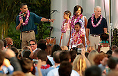 Washington, DC - June 25, 2009 -- Sporting leis, (L-R) United States President Barack Obama, Malia Obama, Michelle Obama, Sasha Obama and Vice President Joseph Biden host a luau for members of Congress and their families on the South Lawn of the White House June 25, 2009 in Washington, DC. In a celebration of the president's home state, the South Lawn was decorated with tiki torches and palm huts and the meal prepared by famous Hawaiian chef Alan Wong. .Credit: Chip Somodevilla - Pool via CNP