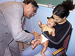 Infant receiving innoculation injection
