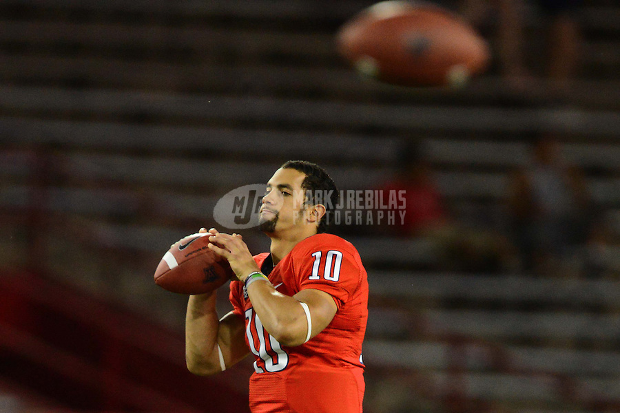 Oct. 20, 2012; Tempe, AZ, USA; Arizona Wildcats quarterback (10) Matt Scott warms up prior to the game against the Washington Huskies at Arizona Stadium. Mandatory Credit: Mark J. Rebilas-
