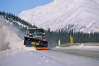 Department of Transportation snow plow clears blowing snow from the James Dalton Highway, (Haul Road) Alaska
