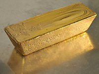 The second melting of a raw gold bar to get a more refined product suitable for export, Medellin, Colombia