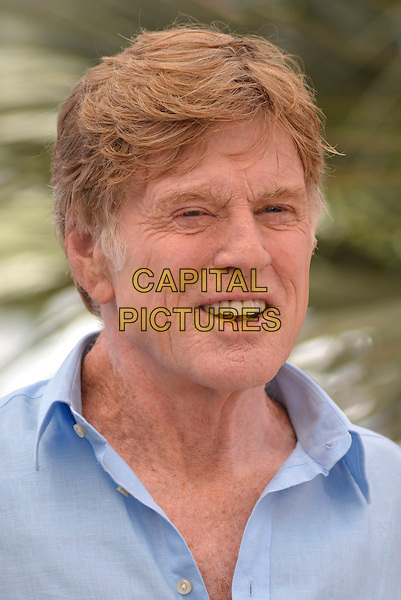 Robert Redford.'All is Lost' photocall at 66th Cannes Film Festival, France..22nd May 2013.headshot portrait blue shirt  smiling mouth open.CAP/PL.©Phil Loftus/Capital Pictures.